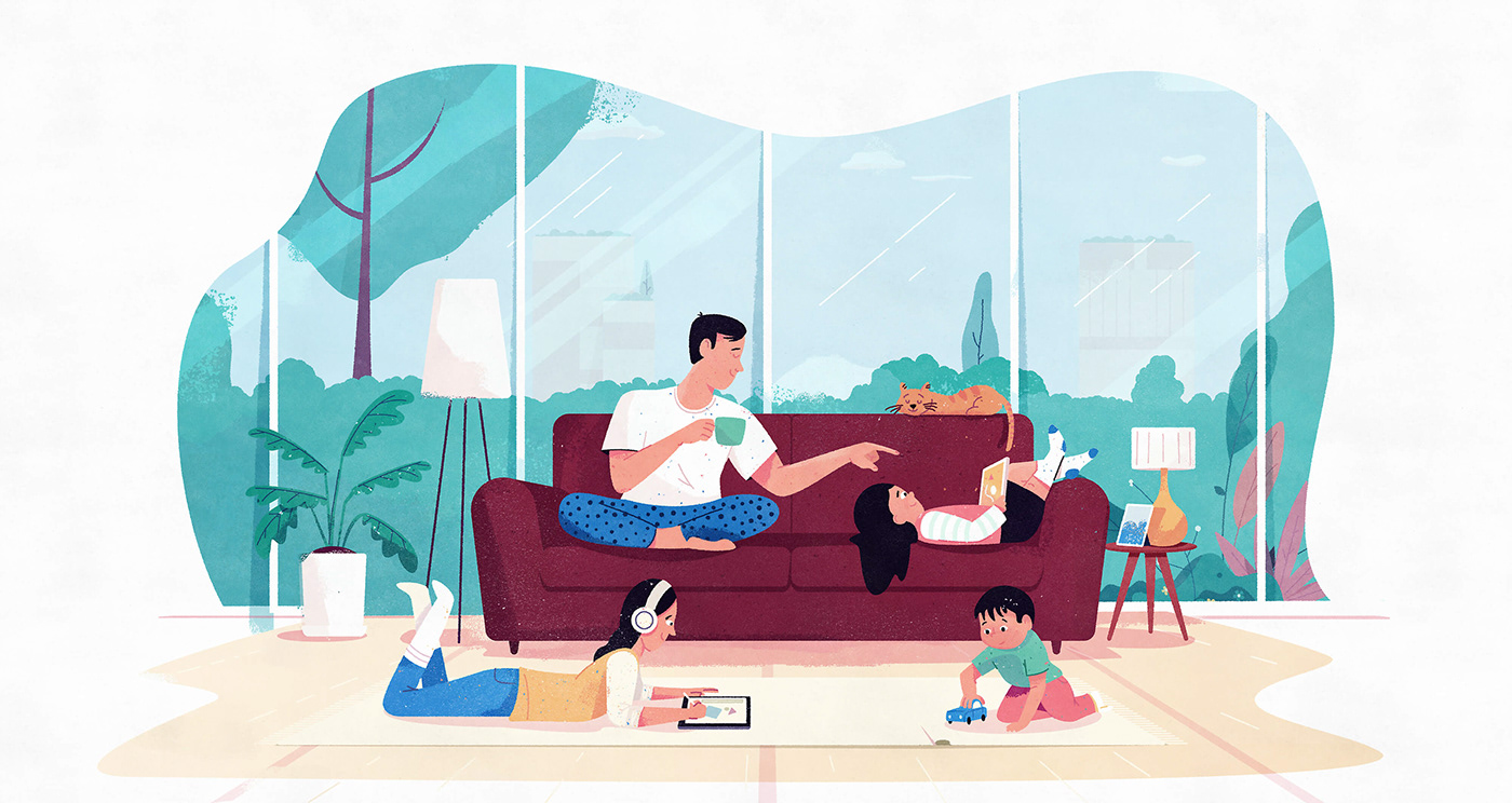 Family sitting on a couch playing in modern home