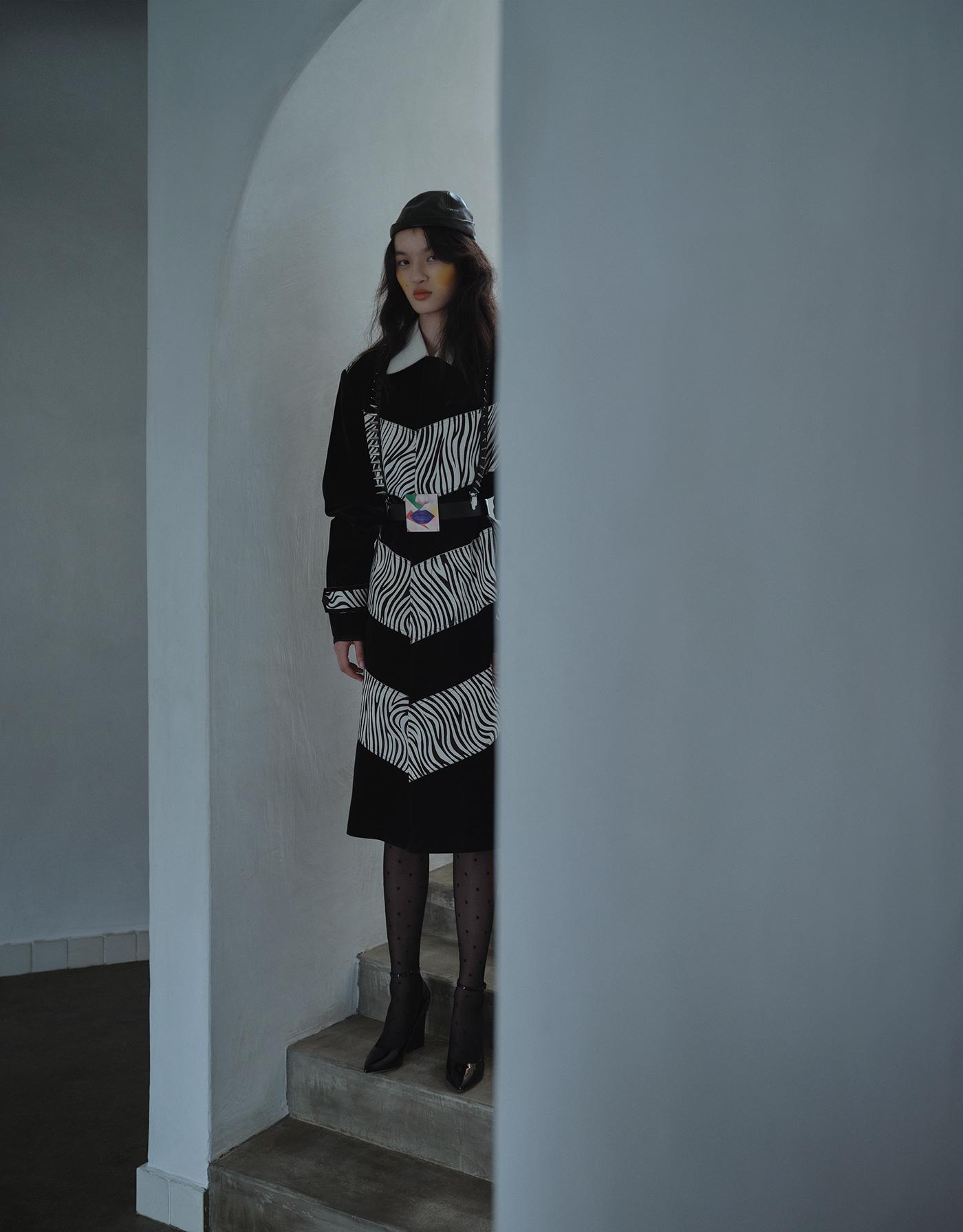 Image may contain: clothing, wall and dress