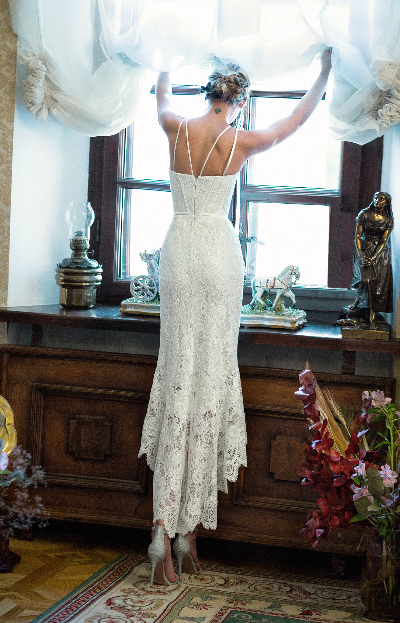 Image may contain: indoor, wedding dress and vase