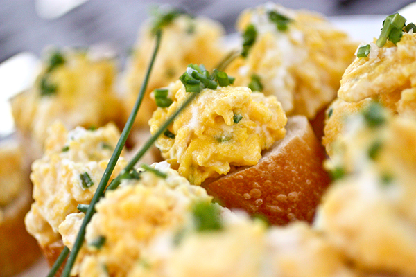Soft-scrambled eggs with ricotta cheese and chives.
