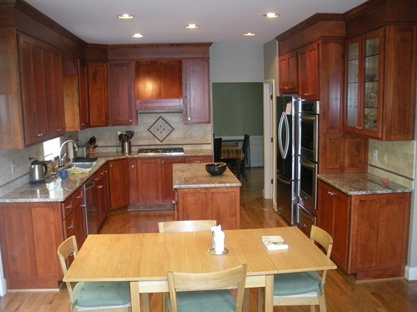 White melamine particle board cabinets before remodeling kitchen