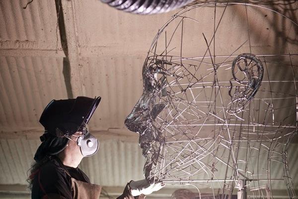 escultura figurativa monumental acero inoxidable