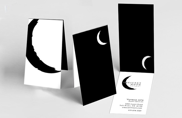 Crescent moon retreat brand development on pratt portfolios business cards with die cut moon through which the white of the main part of the business card can be seen an enlarged moon logo graces the back of the colourmoves