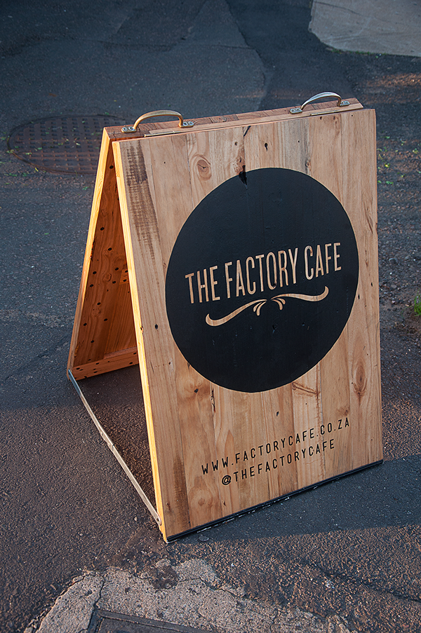 The factory cafe street sign on behance