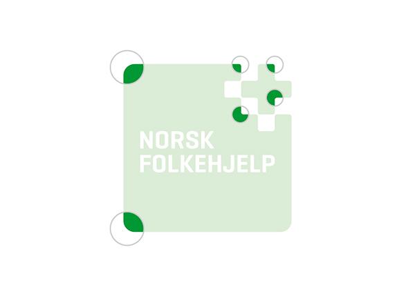 norwegian people's aid Norsk Folkehjelp green magenta cross Aid organisation Humanitarian help
