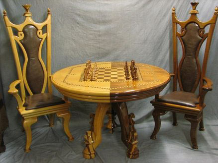 The above chesstable and chairs are the pride and joy of our company's  president, DennisZongker. This table took