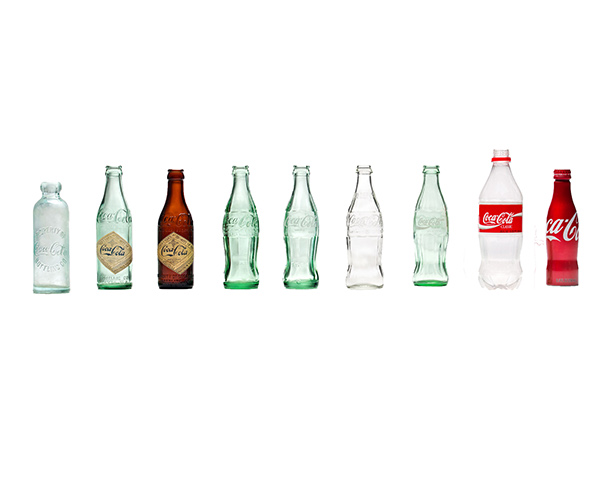 the history of coca cola and its evolution Bottle history evolution bottle #1 - year: 1894 designed with a slight resemblance to the kola nut, an ingredient of coca-cola evolution bottle #5.