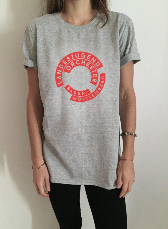 Image may contain: person, wall and shirt