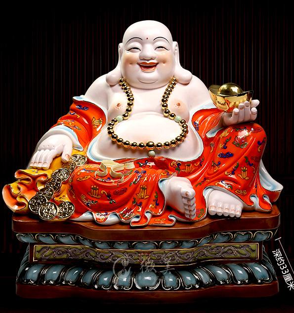 Tượng Phật Di Lặc mang thỏi vàng