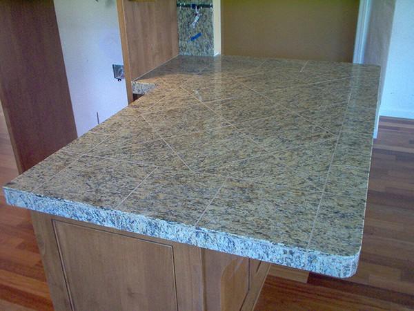 Granite tile countertop with radius corners and polished edges