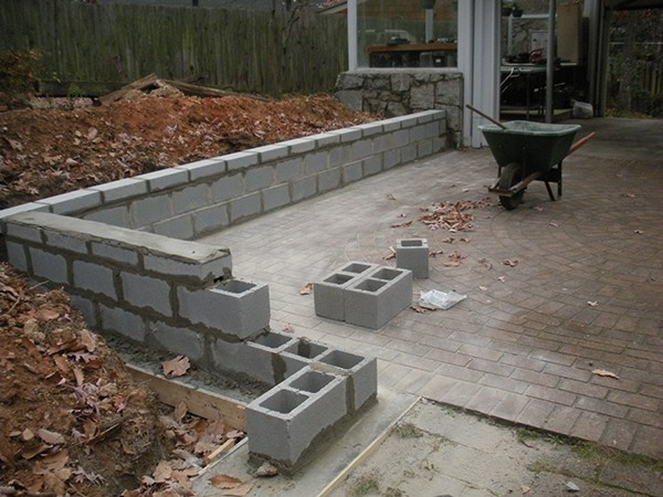 Garden planter wall on behance for How to build a concrete block wall foundation