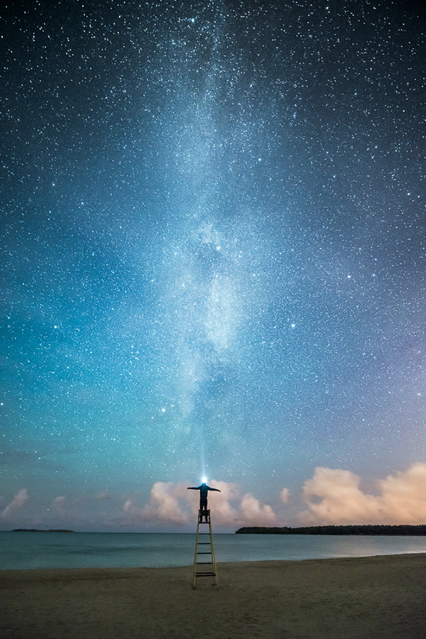 night astrophotography fine art photograph mikko lagerstedt milky way stars boat Shipwreck drifting Dreaming alone figure Silhouette beach