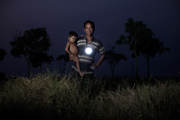 Cambodia moonlight light strobist cambodians children family father mother child Reading cooking night smiling fishing Bike marsh Travel baby