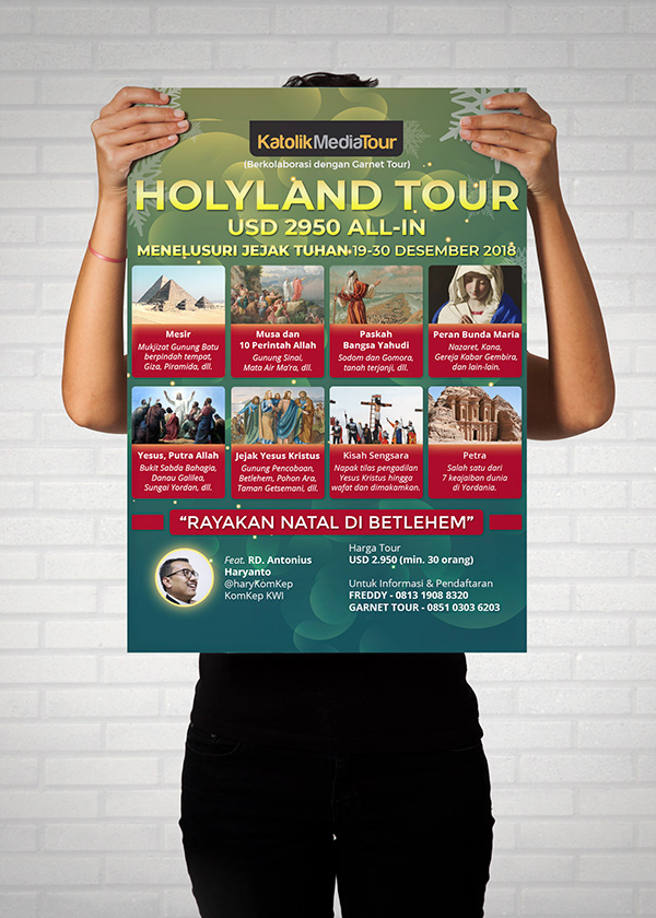 A person holding a brochure or flyer design that promotes holyland tour