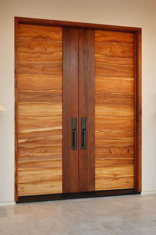 Carved teak entry doors on behance for Modern wooden main door design