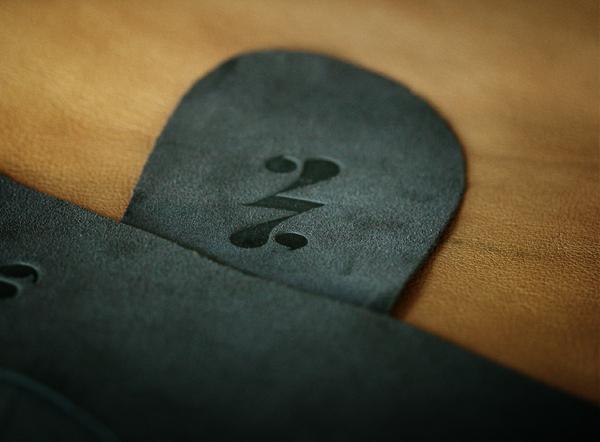 logos ambigram luxury leather