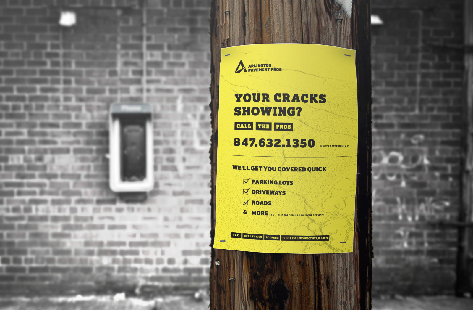 """This image Arlingon Pavement Pros (APP) flyer on a street post, which shows off their new visual identity and brand messaging. """"Your crack's showing? Call the pros."""""""