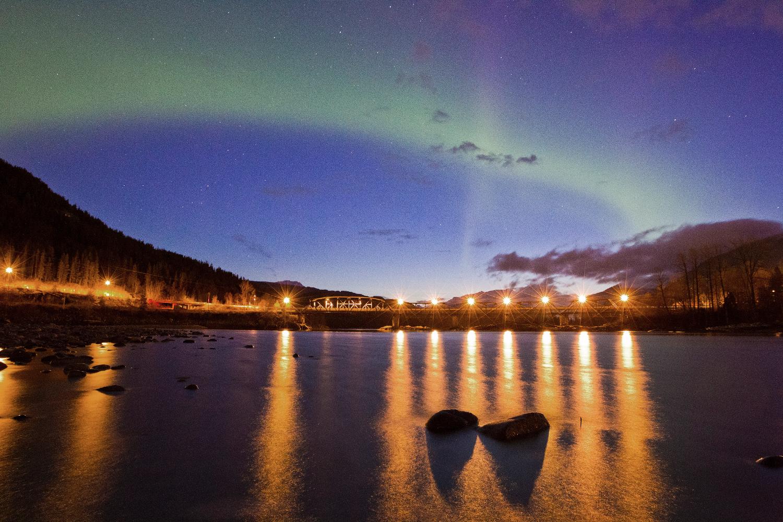 The aurora borealis over the Old Skeena River Bridge, Terrace, BC.