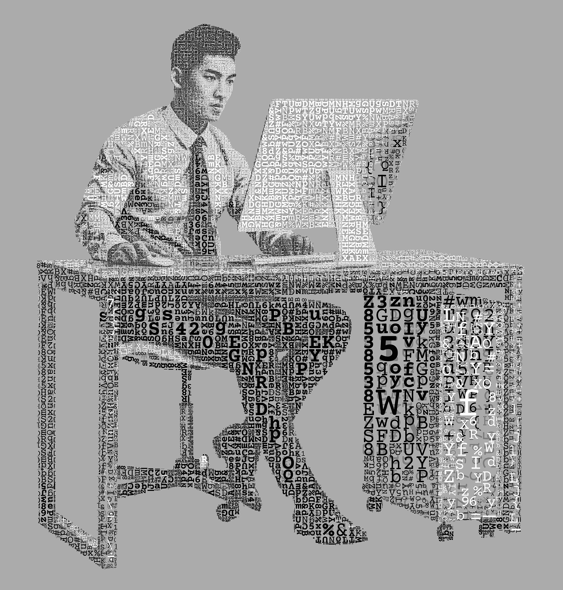 A working guy sitting on his desk staring at the computer monitor