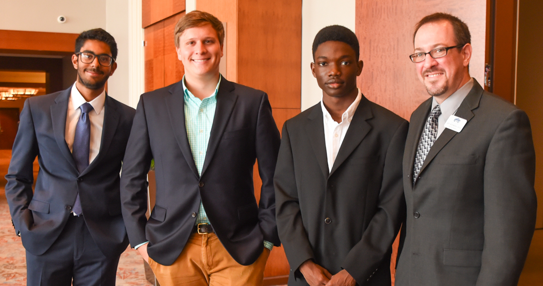 L-R: Myers Park High students Manpreet Singh, William Miller, and Theodore White - CHSNC Educator, Jeff Rothberg (Courtesy of CHSNC)