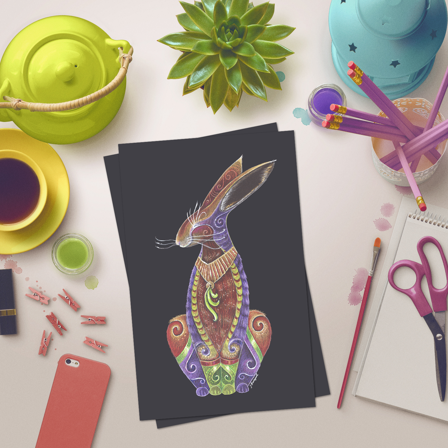 Colourful image of Hare Totem on a desk by Jennifer Hawkyard