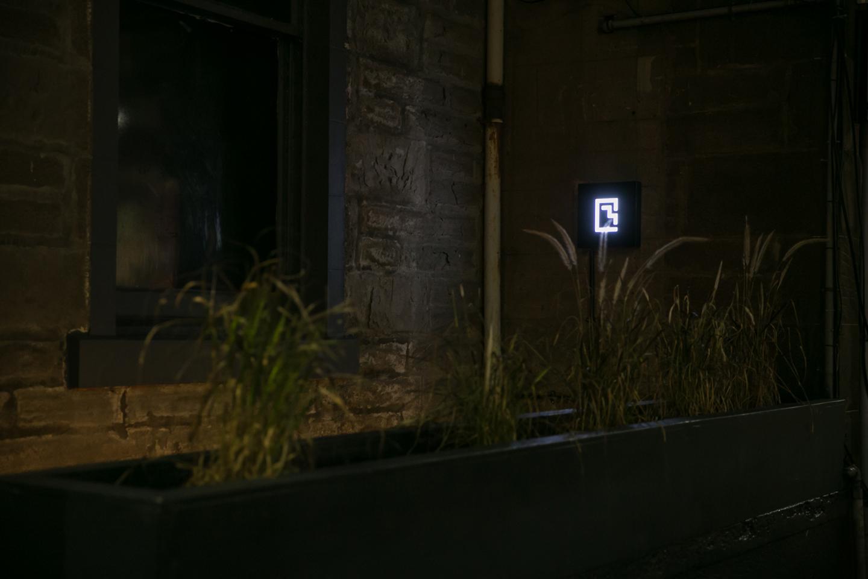 Door Below Signage