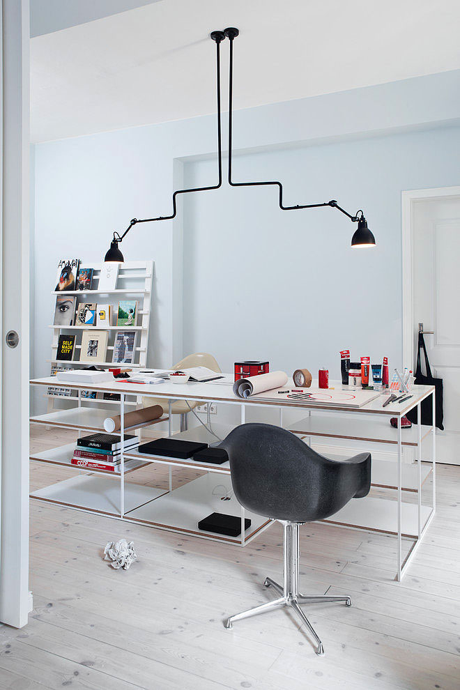 the desk is huge and the industrial hanging lights are right overhead so the work at home professional will