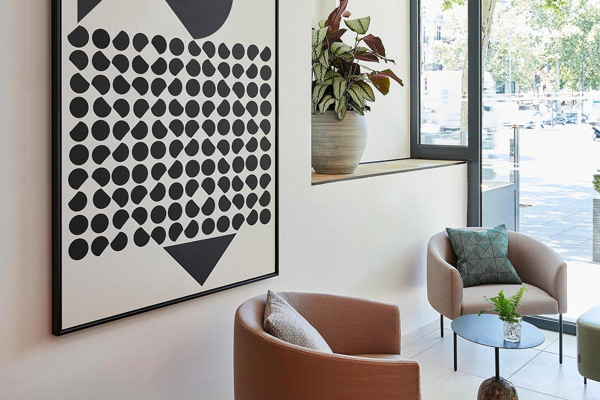 Artworks in Paris. Victor Vasarely inspired artwork. Bar seating. Crowne Plaza Paris Republique