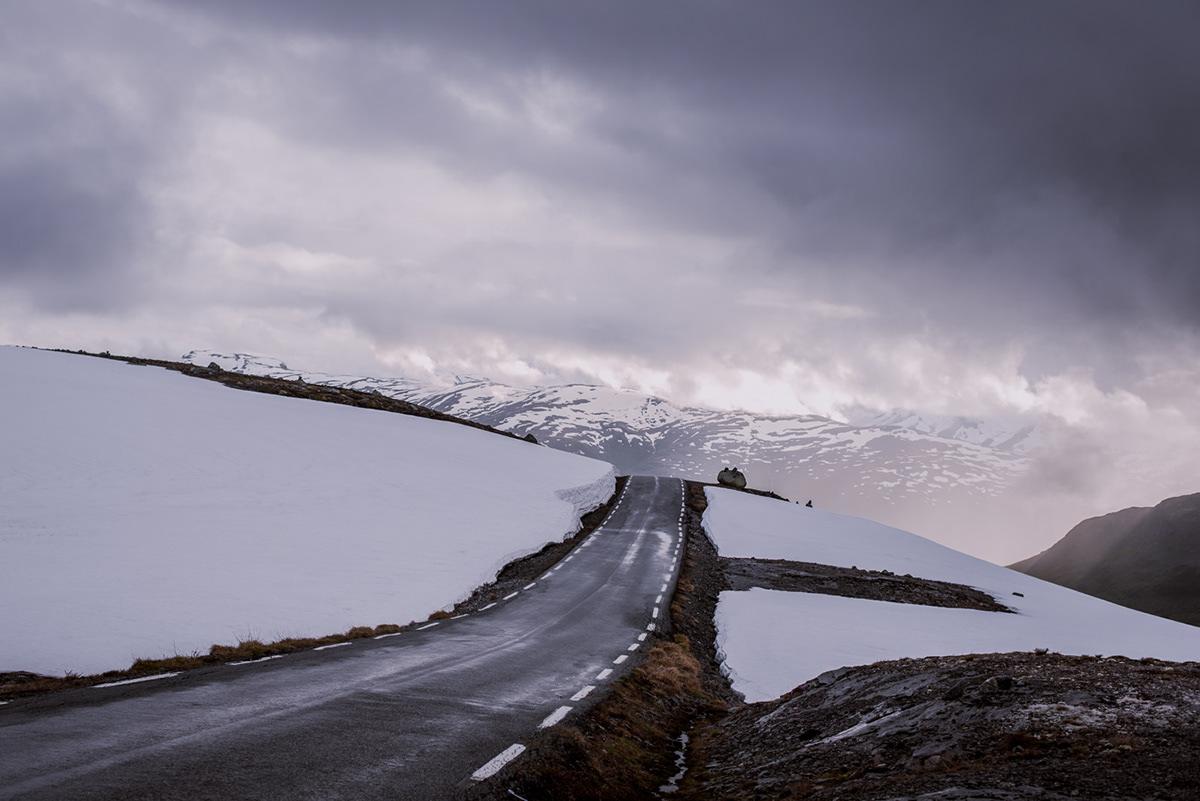 mountain snow road norway Scandinavia lake clouds winter fjord light