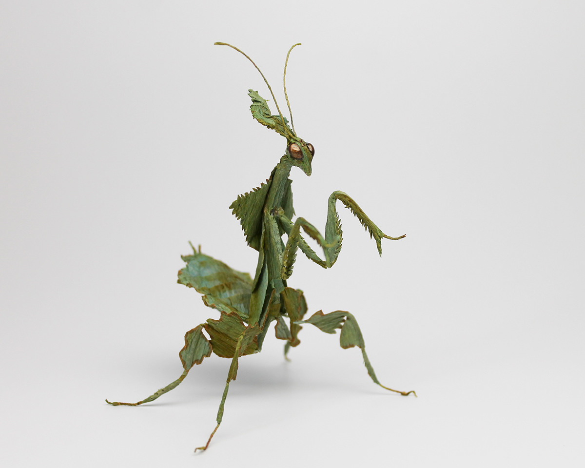 handcrafted sculpture of a ghost mantis in green