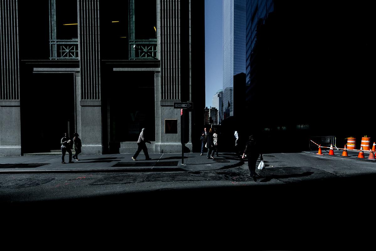 New York people buildings light dark Sun Wall street dowtown