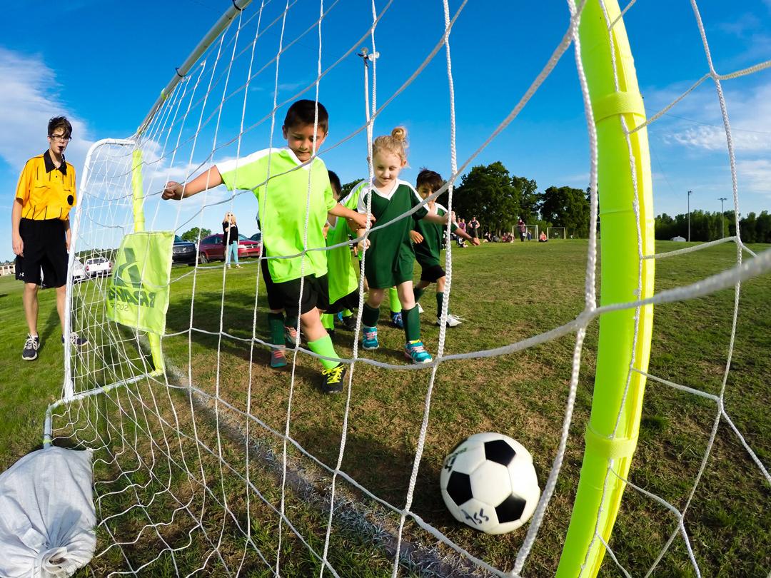child scoring goal