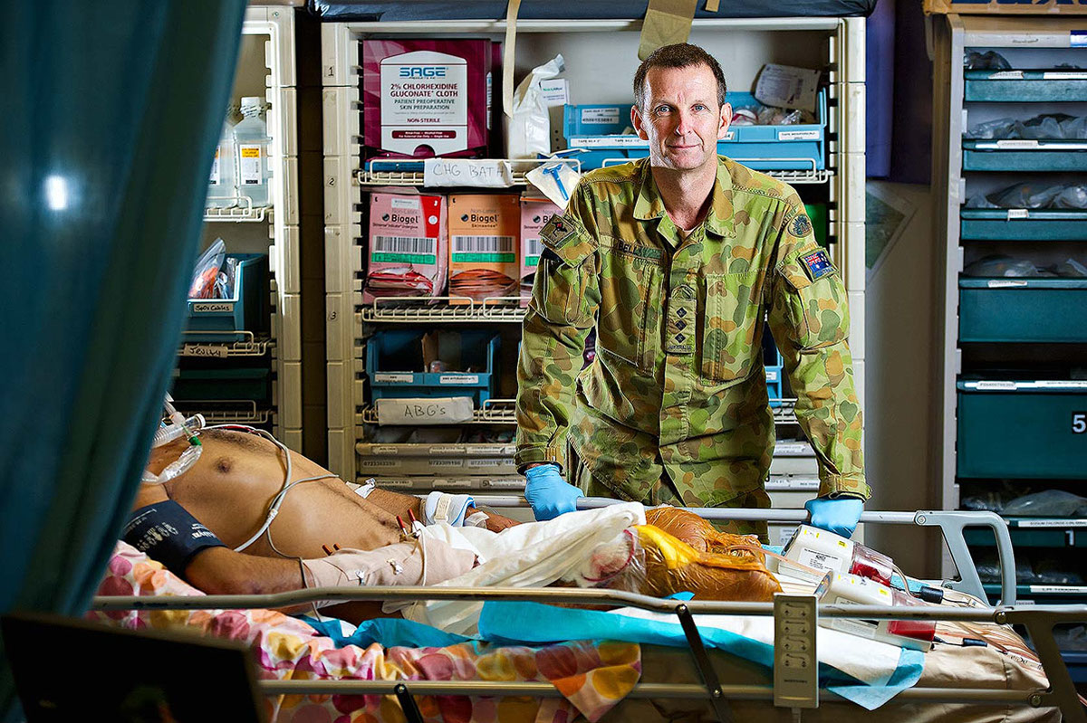 Captain Paul Bell, at the role 3 ICU with an Afghan patient with an improvised explosive device injury