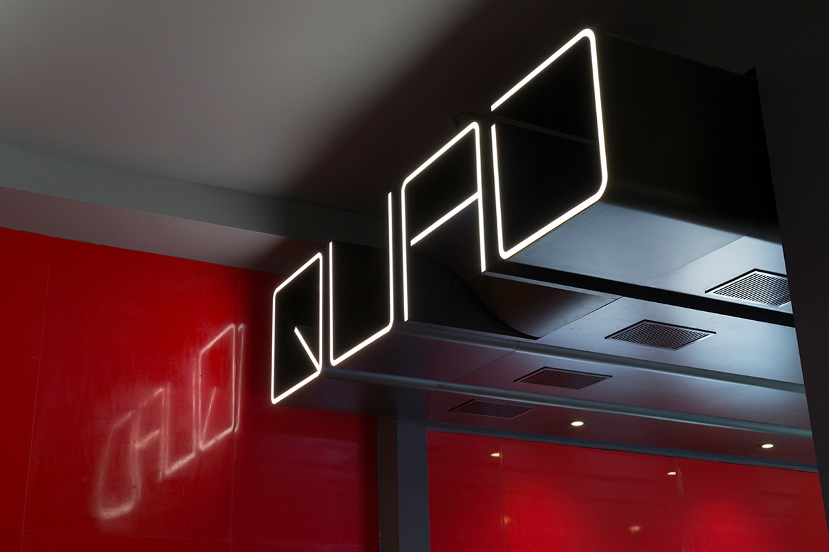 quad cinema identity and wayfinding design on behance