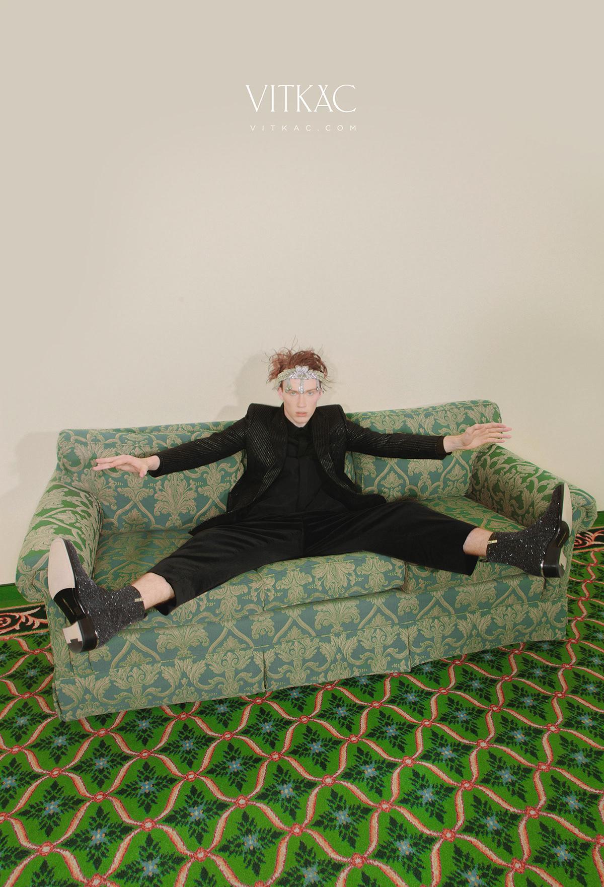 Image may contain: green, wall and clothing