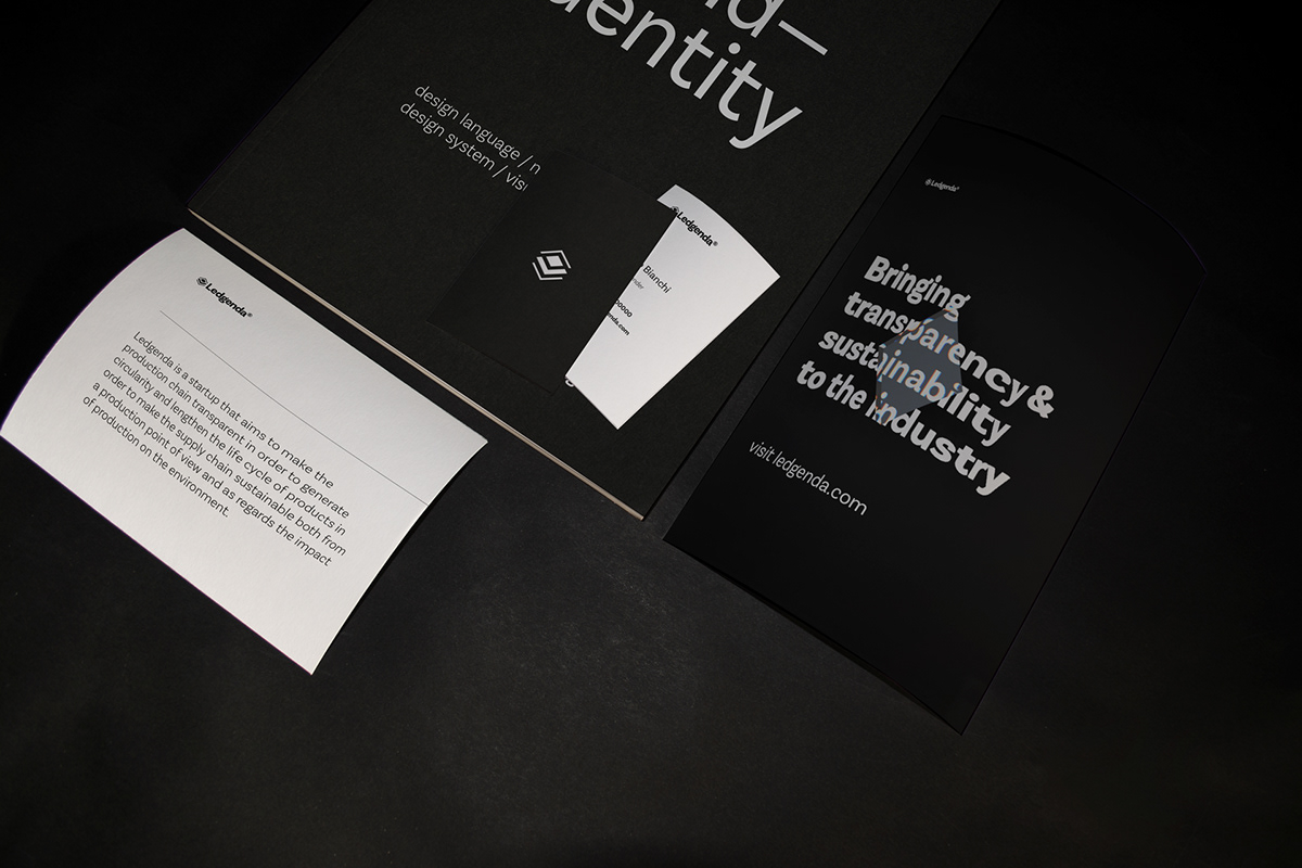 stationery items: brand book, postcards and business cards