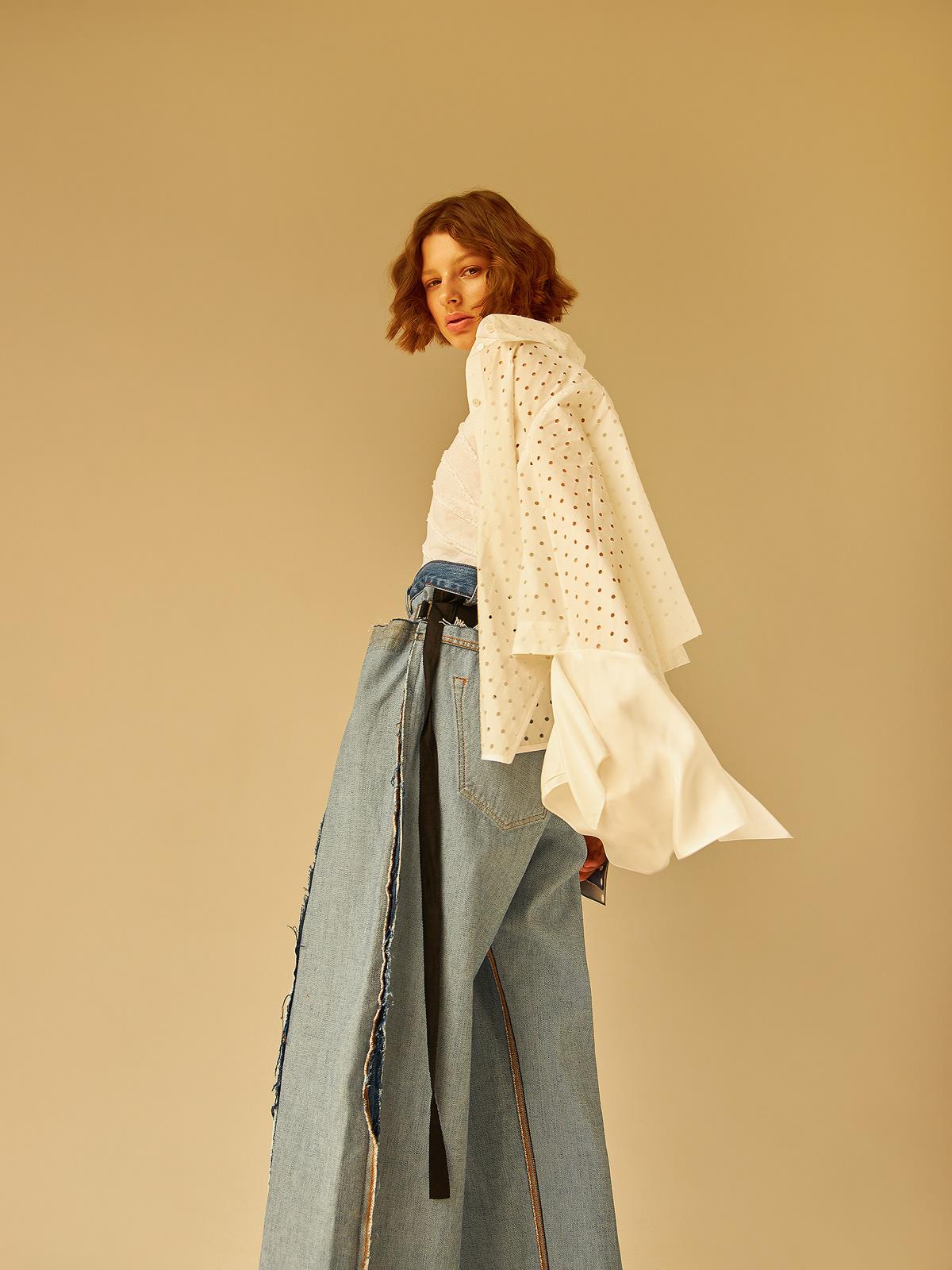 Image may contain: dress, wall and clothing