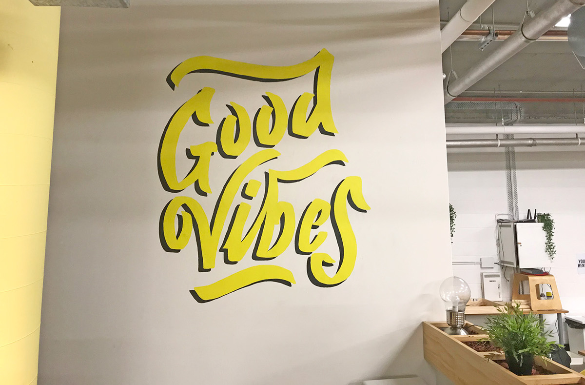 Vibewire \'Good Vibes\' painted lettering mural on Student Show
