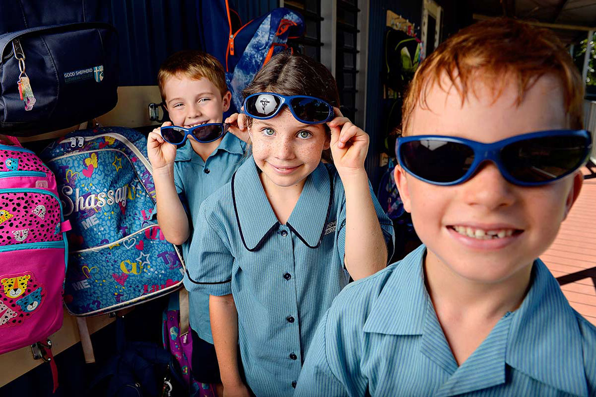 Grade 3 students Tait Gleeson, 7, Katelyn Neilsen, 7, and Joel Munnich, 8, with their new sunglasses.