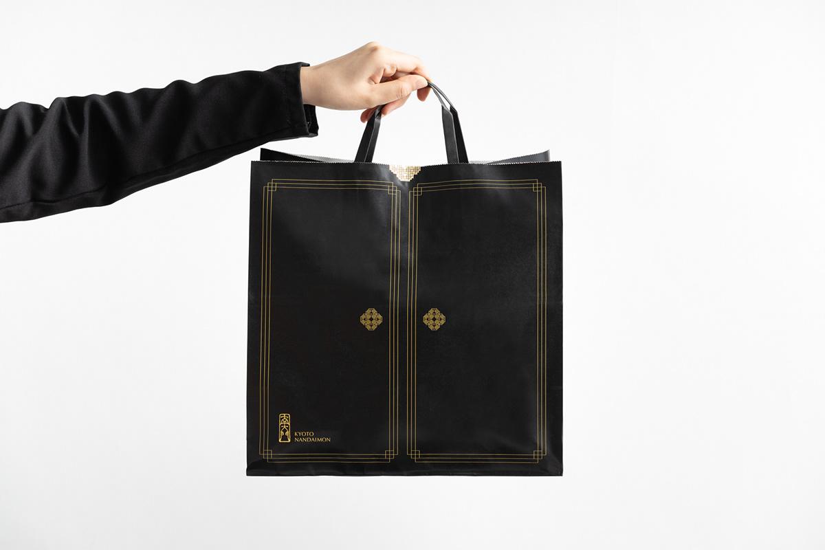 Image may contain: handbag, luggage and bags and wall