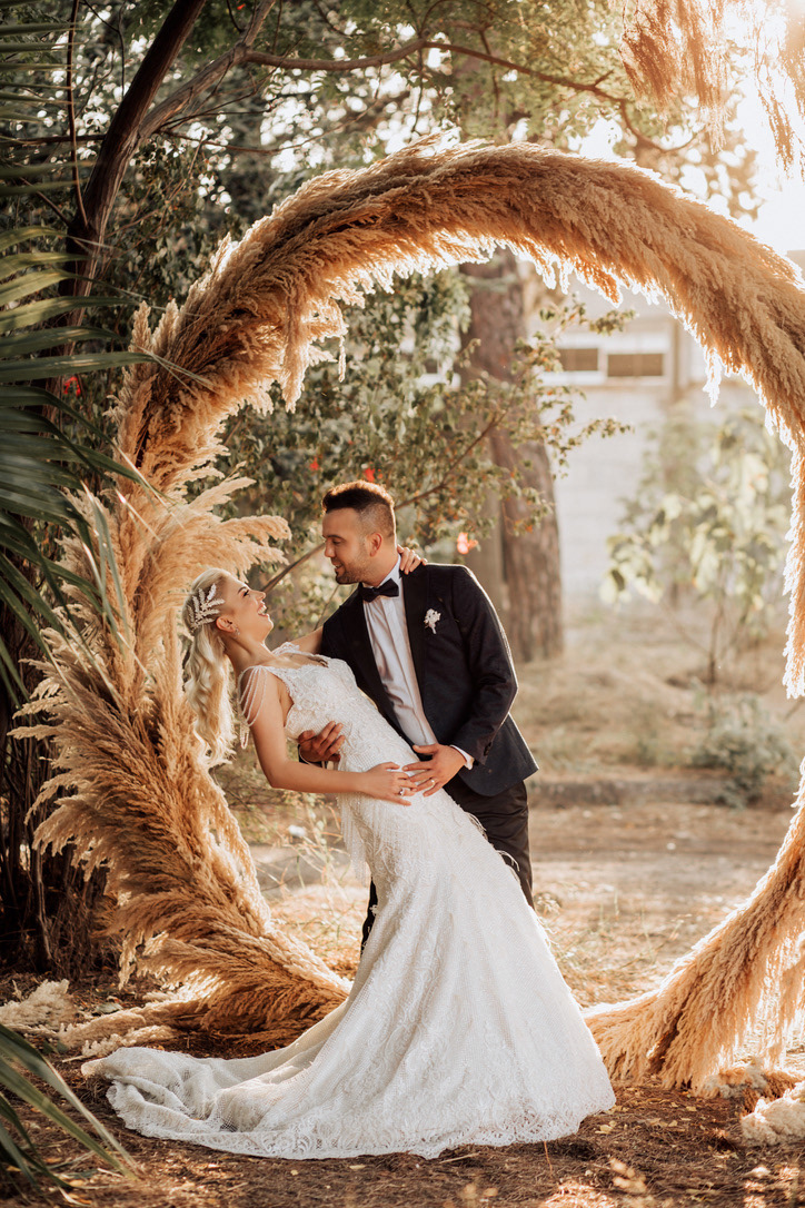 Image may contain: outdoor, tree and wedding dress
