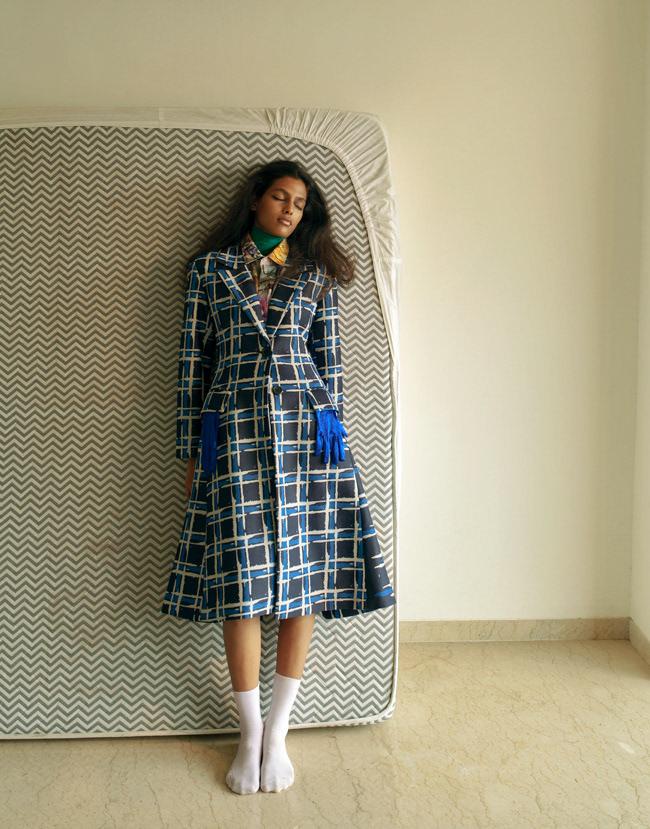 Image may contain: wall, dress and clothing