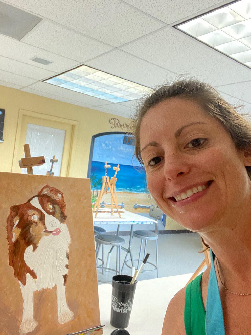 Bricole Reincke with her Red-Tri Miniature Australian Shepherd painting