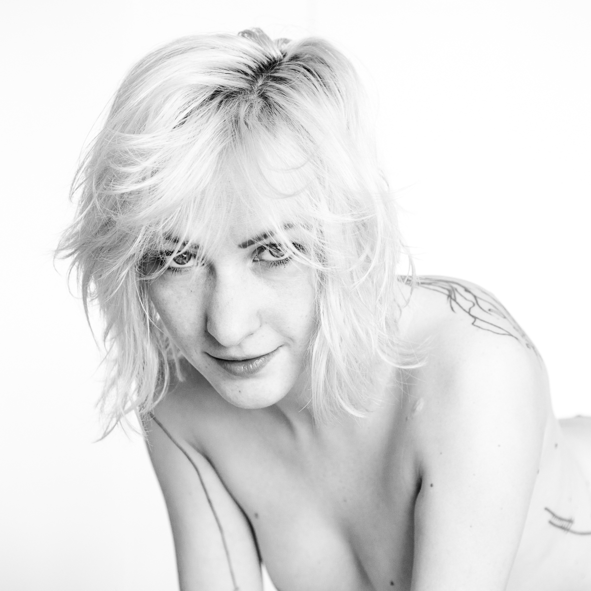 black & white nude boudoir lines tattoo blonde model portrait skin body