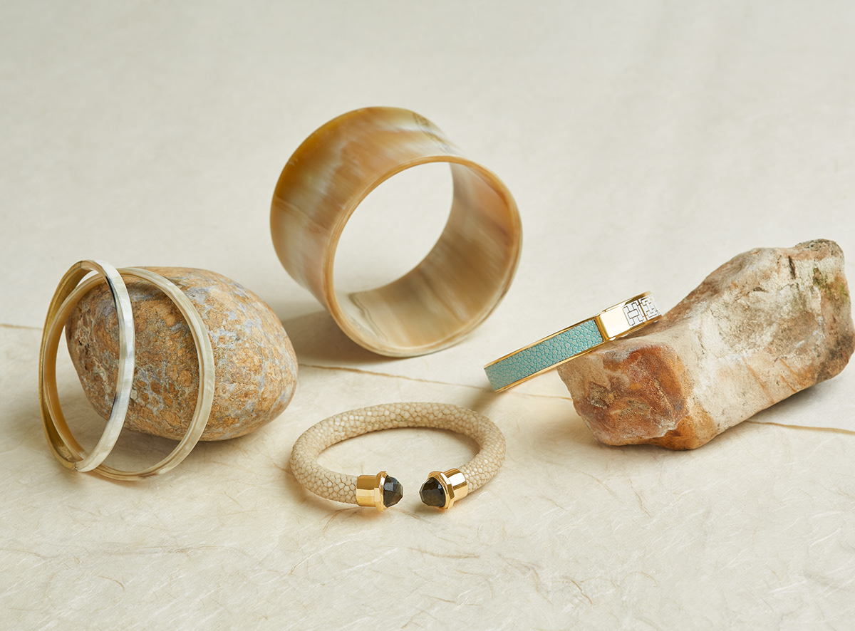 Jewelry still life image by photographer Ella Sophie showing horn, gold and shagreen bracelets
