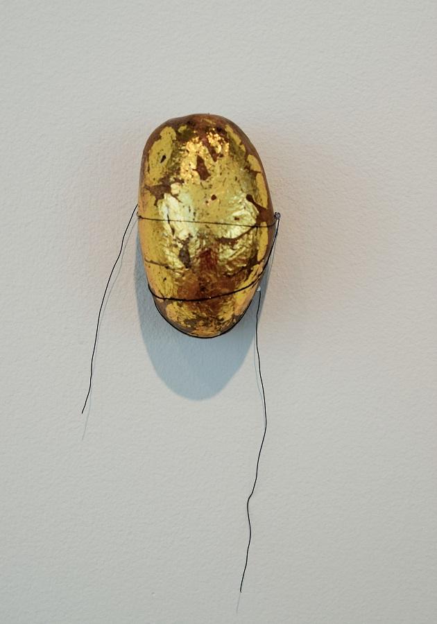 rain rock stone sculpture gold leaf
