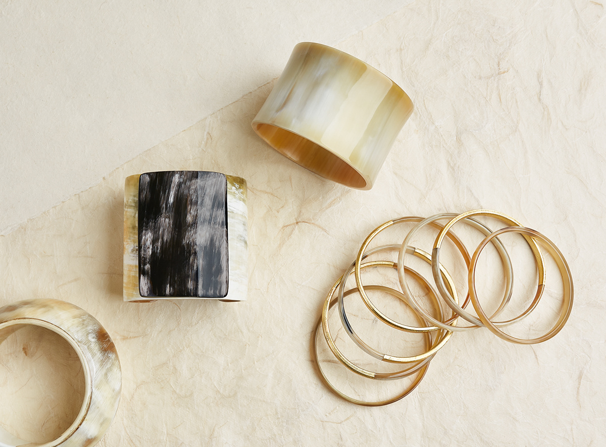 Jewelry still life image by photographer Ella Sophie showing horn and gold bracelets