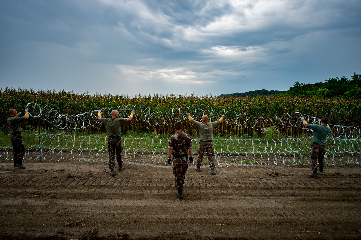 hungarianborderfence border fence Europe migration migrants Refugees wiredfence soldiers hungary