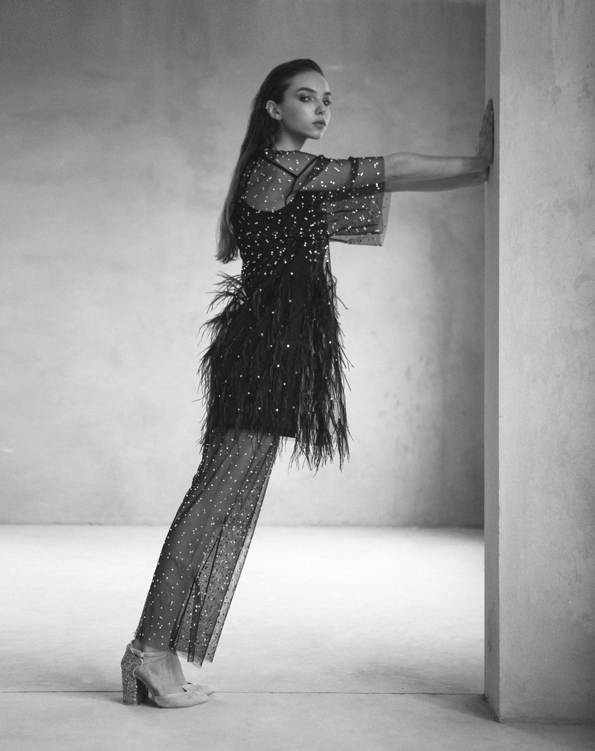 Image may contain: wall, dress and high heels