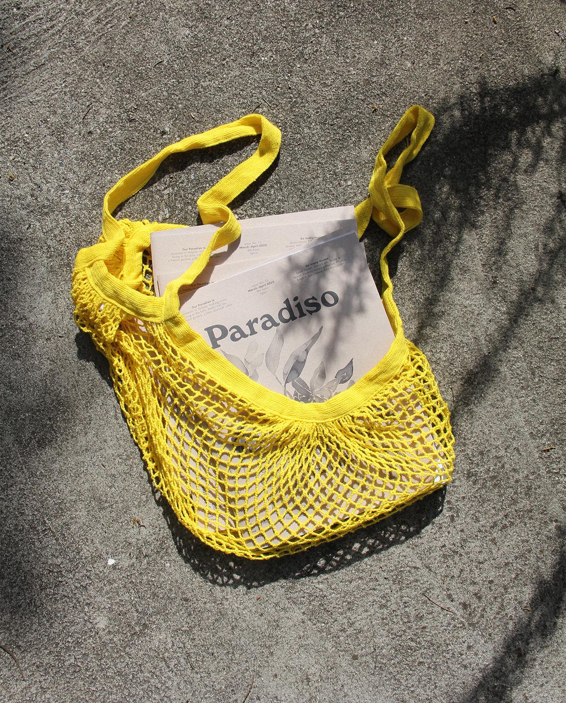 Image may contain: yellow and handbag